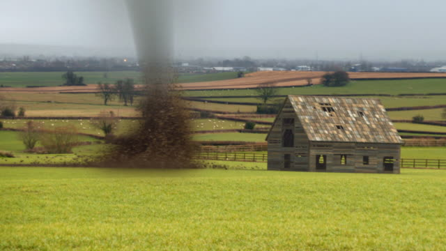 stockvideo's en b-roll-footage met tornado destroying barn - beschadigd