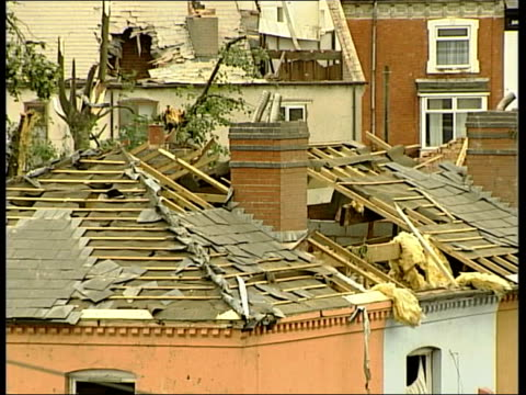 tornado in birmingham: aftermath; england: birmingham: ext piles of bricks on grass, fallen chimney breasts and roofless houses / tgv across damaged... - torso umano video stock e b–roll