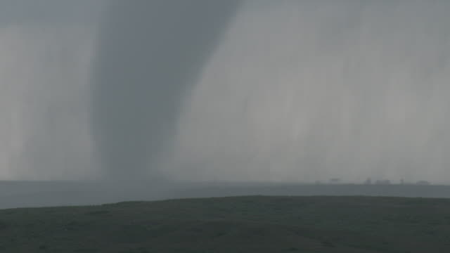 Tornado On The Ground Dangerously Close To A Farm