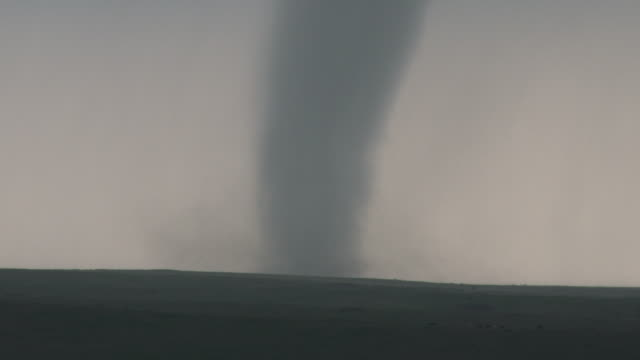 tornado on the ground tearing across rural farmland - blowhole stock videos & royalty-free footage