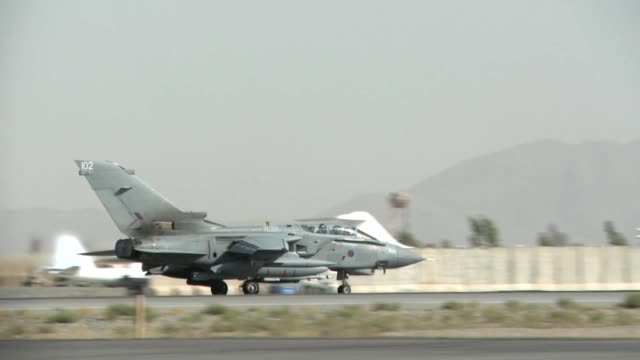 stockvideo's en b-roll-footage met raf tornado preparing and taking off with full afterburners for a mission at kandahar air field in support of operation enduring freedom - operation enduring freedom