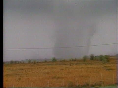 tornado spins across the ground. - prairie stock videos & royalty-free footage