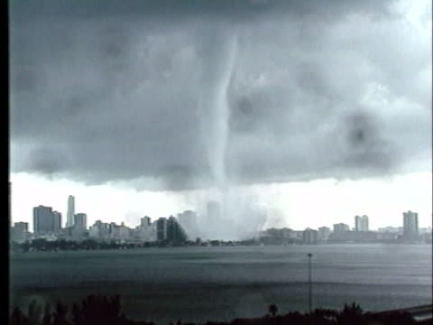 tornado spins in the middle of miami. - blowhole stock videos & royalty-free footage