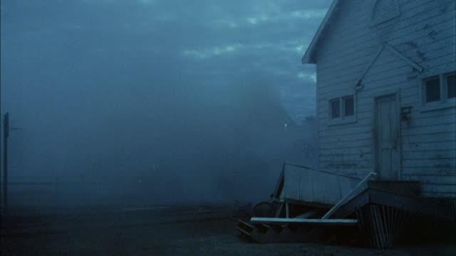 a tornado strikes two houses in kansas. - naturkatastrophe stock-videos und b-roll-filmmaterial