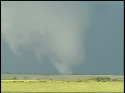 a tornado swirls on the prairie in oklahoma. - oklahoma stock videos & royalty-free footage