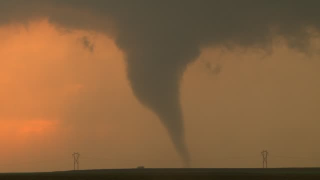 A tornado touches down at sunset near Rozel KS