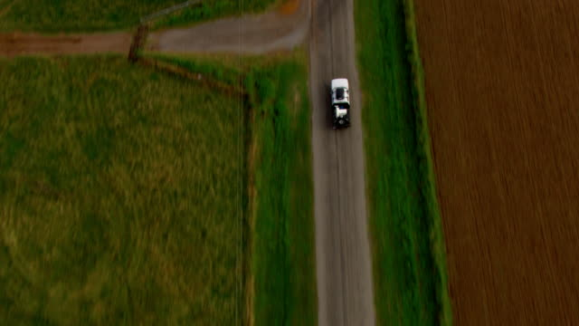 a tornado-chasing truck mounted with radar drives past open farmland. - open field stock videos & royalty-free footage
