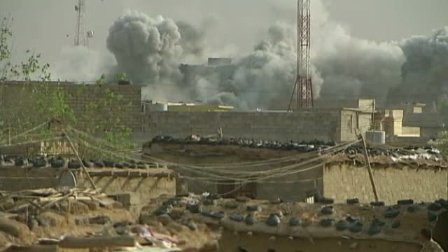 tornados continue bombing strikes to assist kurdish forces; iraq: rabia: ext tank kurdish soldiers on tank below kurdish flag soldiers chatting and... - damaged stock videos & royalty-free footage