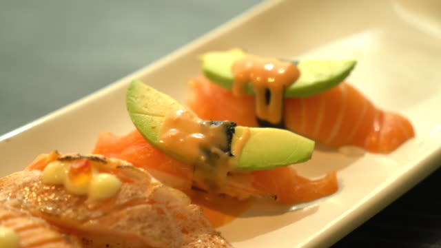 toro salmon burned nigiri - nigiri stock videos and b-roll footage
