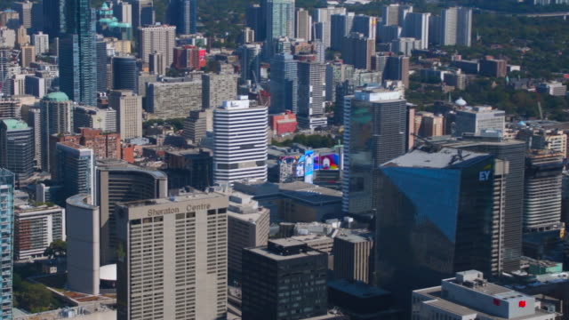 Toronto, Canada: aerial view of the downtown district and skyline in daytime. Left pan
