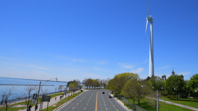 toronto canada: aerial view of the lakeshore boulevard at the height of ontario place. - wind turbine stock videos & royalty-free footage