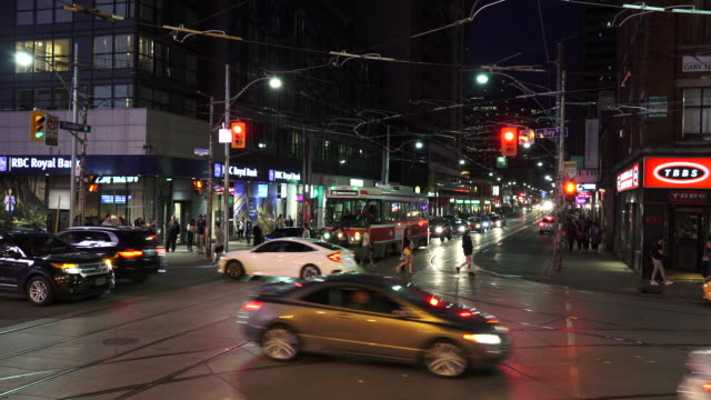Toronto, Canada: aerial view traffic and everyday lifestyle in the downtown district at night in the Canadian city capital of the province of Ontario