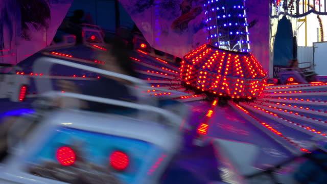 toronto, canada: amusement park equipment with blue and red lights - 24コマ撮影点の映像素材/bロール