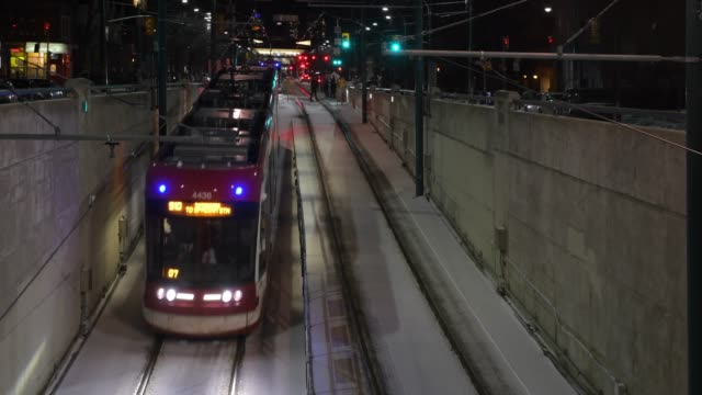 toronto, canada, cable streetcar entering a subway station in the downtown district - tram stock videos & royalty-free footage