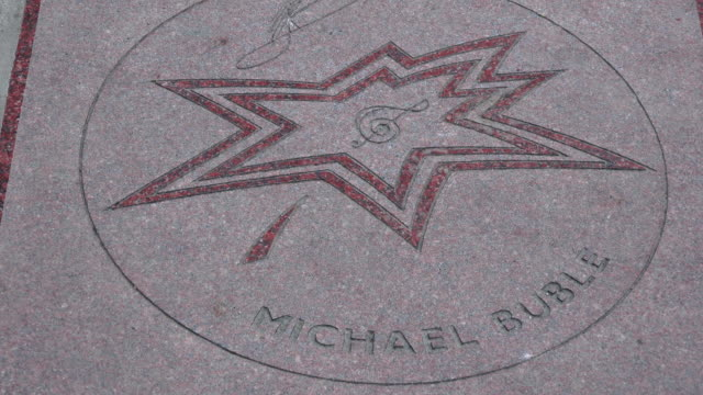 toronto, canada: canada's walk of fame, michael buble star. people walks over it in everyday routine of torontonians and visitors to the downtown. - walk of fame bildbanksvideor och videomaterial från bakom kulisserna
