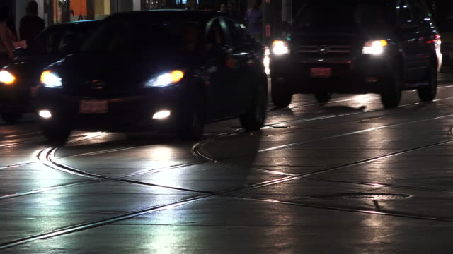 Toronto, Canada: cars headlights in the downtown district traffic at night.