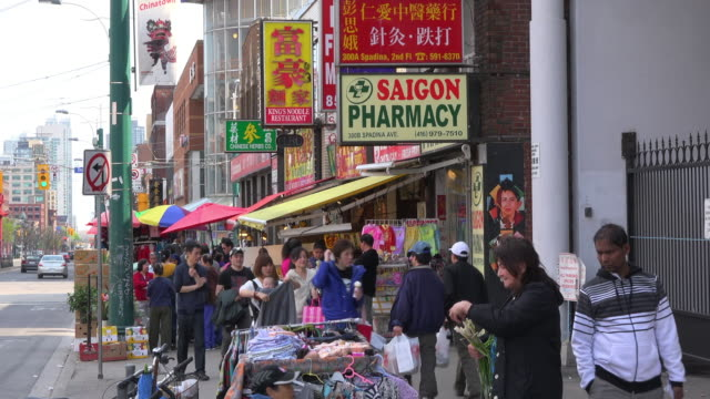 toronto, canada: chinatown business selling items in the sidewalk - chinatown stock videos & royalty-free footage