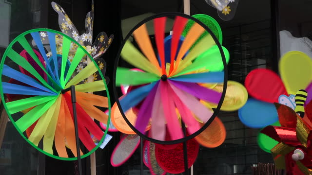 toronto, canada: chinatown, close up of colourful items for sale in a urban sidewalk - consumerism stock videos & royalty-free footage