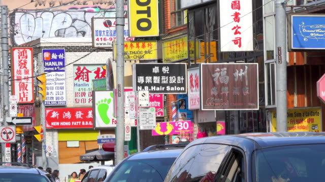 toronto, canada: chinatown scene during the daytime - toronto stock-videos und b-roll-filmmaterial