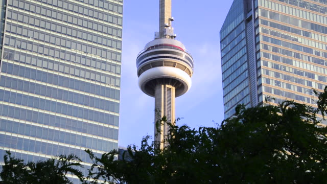Toronto Canada: CN Tower amid downtown district skyscrapers during the daytime