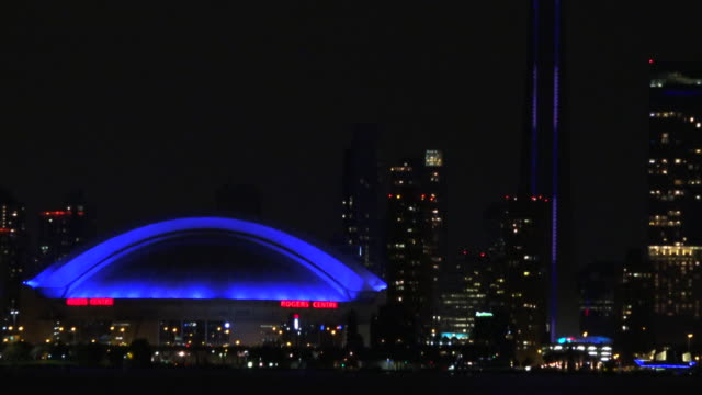toronto, canada: cn tower and rogers centre, tilt up - toronto stock videos & royalty-free footage