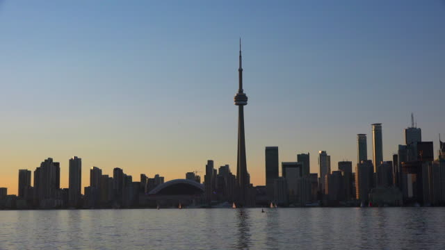 Toronto, Canada: CN Tower and the city urban skyline at dusk hours. The Canadian National tower is the tallest free standing structure in the Western Hemisphere.