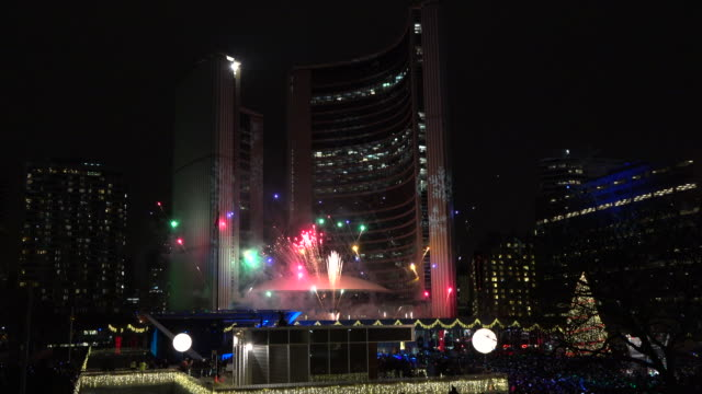 Toronto, Canada: fireworks New City Hall at night in Nathan Phillips Square. The famous tourist attraction place is part of the downtown district of the Canadian city capital of the province of Ontario