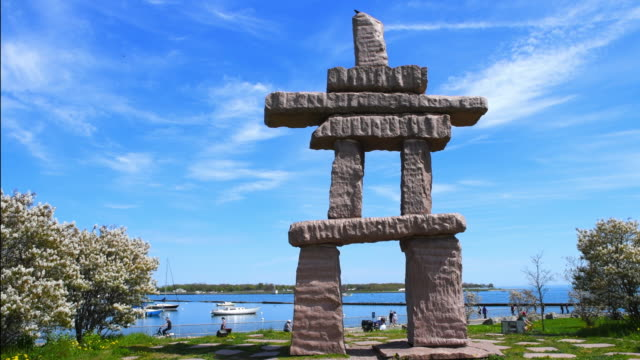 toronto canada: first nations stone sculpture in the exhibition place grounds - tradition stock videos & royalty-free footage