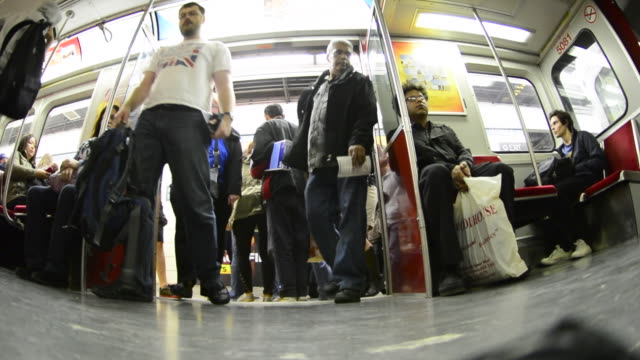 toronto canada: inside a subway train on line 2, city lifestyle in the public transportation system - bahnreisender stock-videos und b-roll-filmmaterial