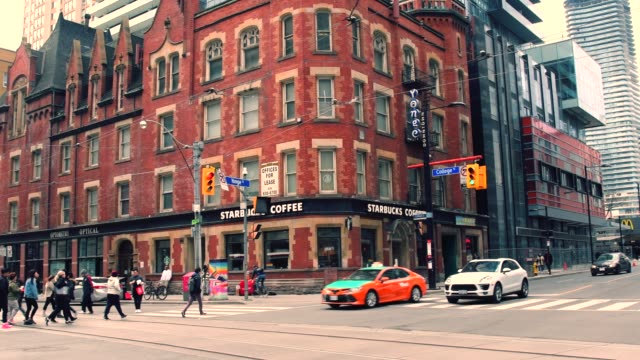 toronto, canada, intersection of yonge and college streets - traditionally canadian stock videos & royalty-free footage