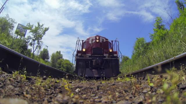 toronto canada: low angle of a train passing over the camera - 鋼点の映像素材/bロール