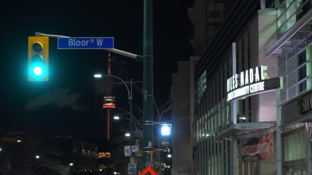 stockvideo's en b-roll-footage met toronto, canada, miles nadal center and the cn tower at night - ontario canada