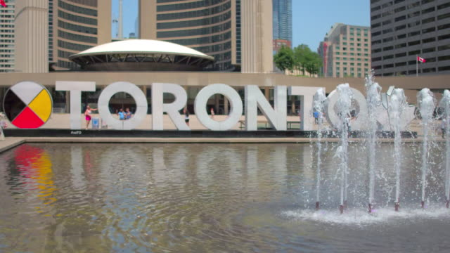 toronto canada: nathan phillips square in the daytime - native american ethnicity stock videos & royalty-free footage