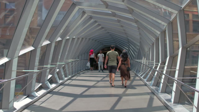 toronto canada: new pedestrian bridge joining the eaton centre and the hudson bay store - local landmark stock videos & royalty-free footage