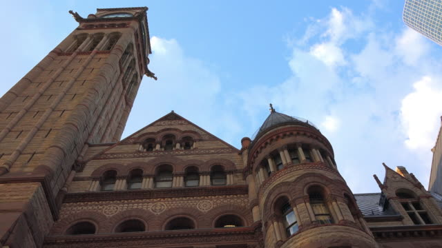 toronto, canada: old city hall romanesque revival building exterior, tilt down - revival stock videos & royalty-free footage