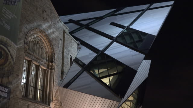 toronto, canada: rom or royal ontario museum, tilt of the modern facade of the famous place - ontario canada stock videos & royalty-free footage