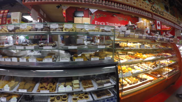 toronto canada: saint lawrence market, a pastry and sweets shop - baked pastry item stock videos & royalty-free footage