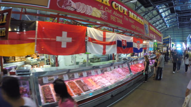 toronto canada: saint lawrence market, meat shop with flags of teams in the russia soccer world cup - world sports championship stock videos & royalty-free footage
