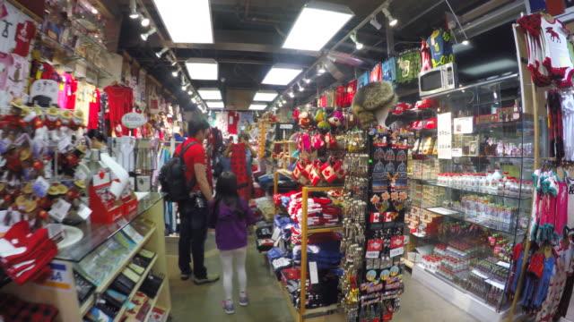 toronto canada: saint lawrence market, souvenir store - souvenir stock videos & royalty-free footage