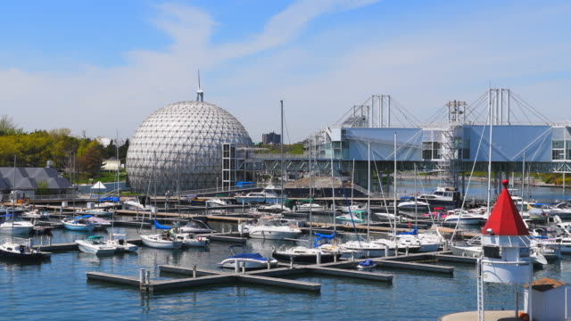 toronto canada: the marina inside ontario place featuring the exterior of the cinesphere. - marina stock videos & royalty-free footage