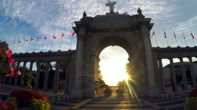 toronto, canada: the princes' gates at exhibition place, point of view of person walking towards the entrance and sunset at the gates - the past stock videos & royalty-free footage