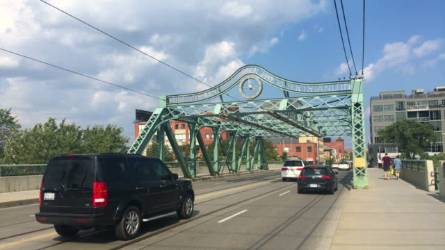 Toronto, Canada: The Queen Street Viaduct in daytime. Point of view of person walking in the sidewalk