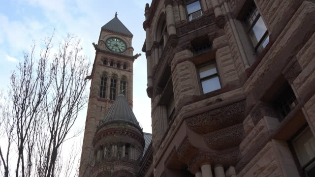 toronto, canada: tilt down of the old city hall external wall - local landmark stock videos and b-roll footage