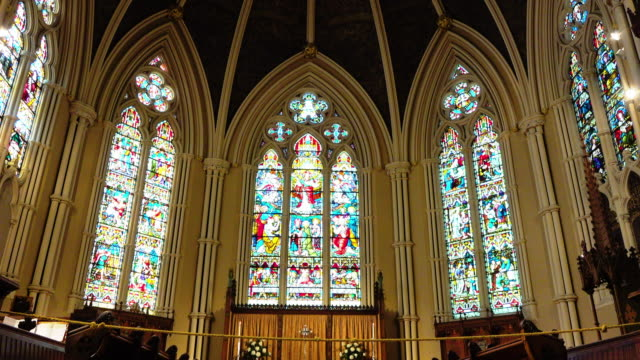 toronto, canada, tilt down the stained glass windows in st. james cathedral - katholizismus stock-videos und b-roll-filmmaterial