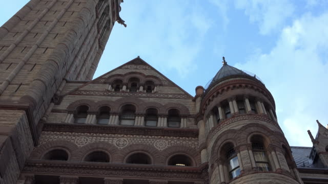 toronto, canada: tilt up of an old city hall red stone wall - local landmark stock videos and b-roll footage