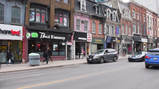 Toronto, Canada, traffic and low-rise historic buildings in Yonge street