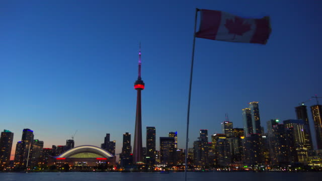 toronto, canada: urban skyline at dusk, point of view from a tour boat in lake ontario - cn tower stock-videos und b-roll-filmmaterial