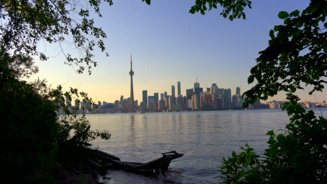 Toronto, Canada: Urban skyline, point of view from the Centre Island at dusk