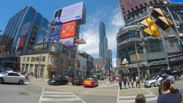 toronto canada: walking in the yonge-dundas square, point of view during the daytime - ontario kanada stock-videos und b-roll-filmmaterial