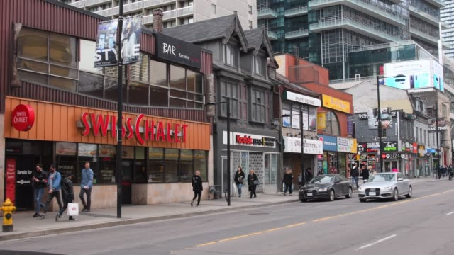 toronto, canada, walking in yonge street during the day - pressure point stock videos & royalty-free footage